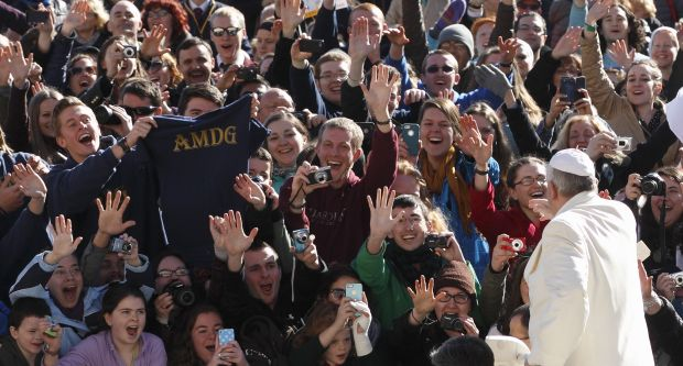 Students from the Gaming, Austria, campus of Franciscan University of Steubenville, Ohio, cheer as Pope Francis arrives to lead his general audience in St. Peter's Square at the Vatican March 5. (CNS photo/Paul Haring) (March 5, 2014) See POPE-AUDIENCE March 5, 2014.